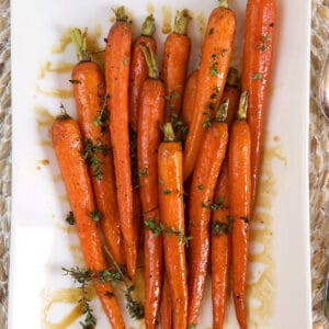 Carrots are placed in the center of a white plate.