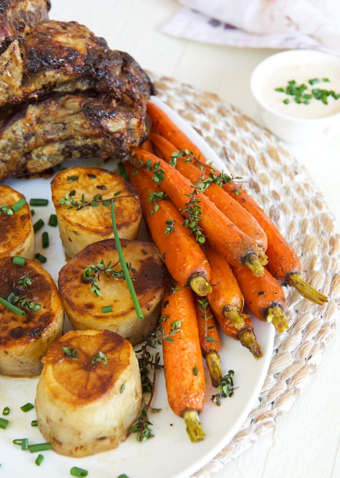 Cooked carrots are placed on a plate next.