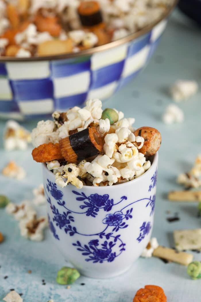 A blue and white cup contains a small portion of hurricane popcorn.