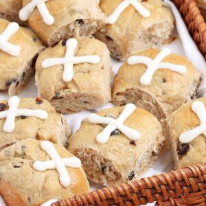 Hot Cross Buns in a wicker tray.