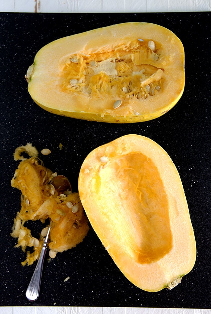 Seeds have been scooped out of half a squash.