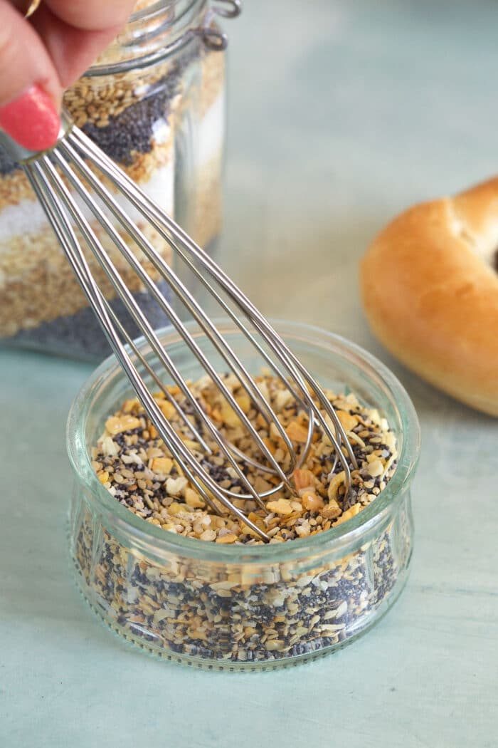 Everything Bagel Seasoning being whisked in a small jar.