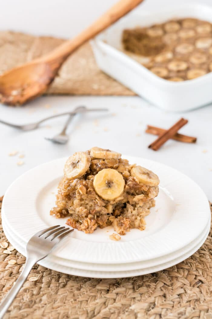 Bananas baked oatmeal on a white plate with a fork.