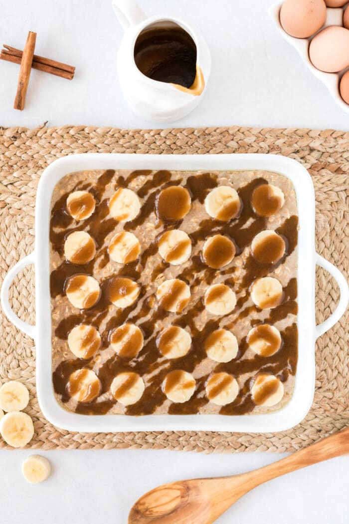 Bananas Foster Baked oatmeal in a white baking dish before it's baked.