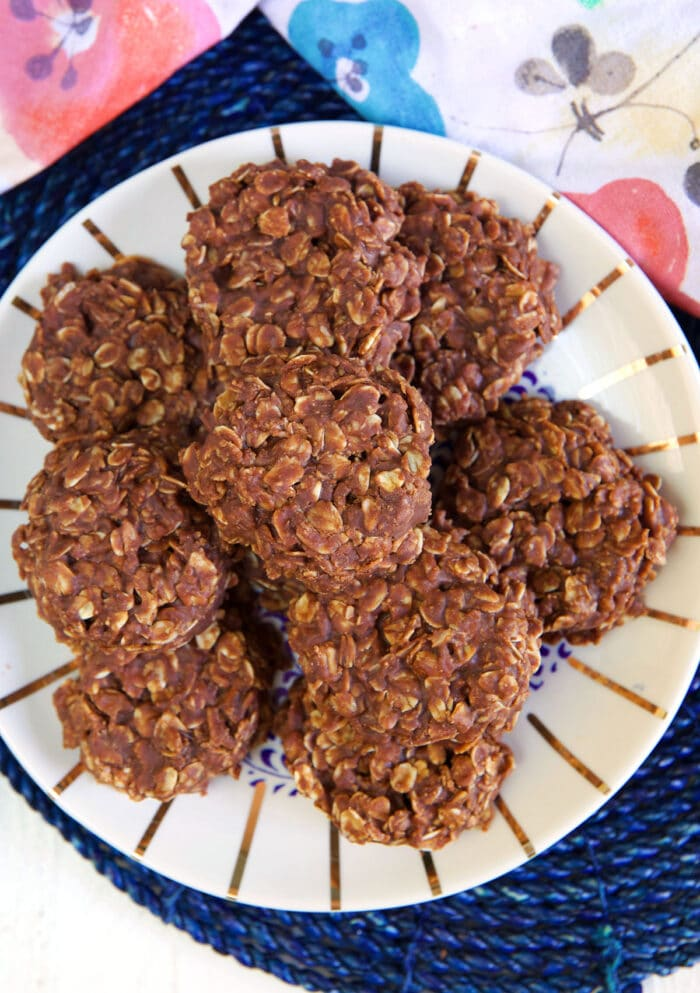 A batch of chocolate oatmeal cookies are on a plate.