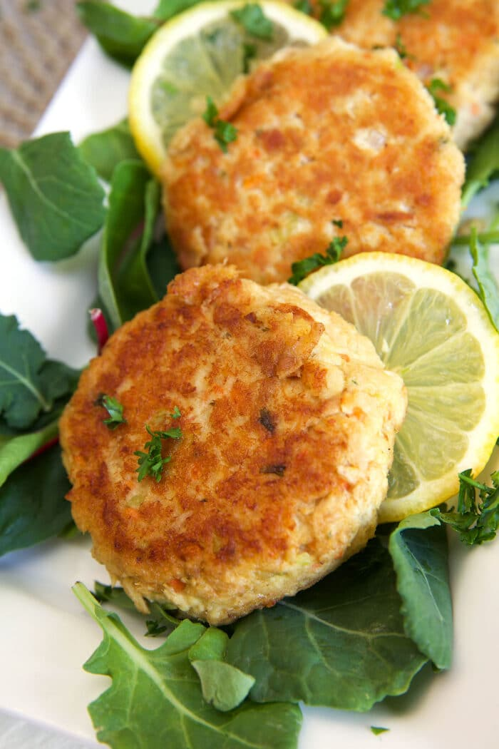 Tuna patties are on a white plate.