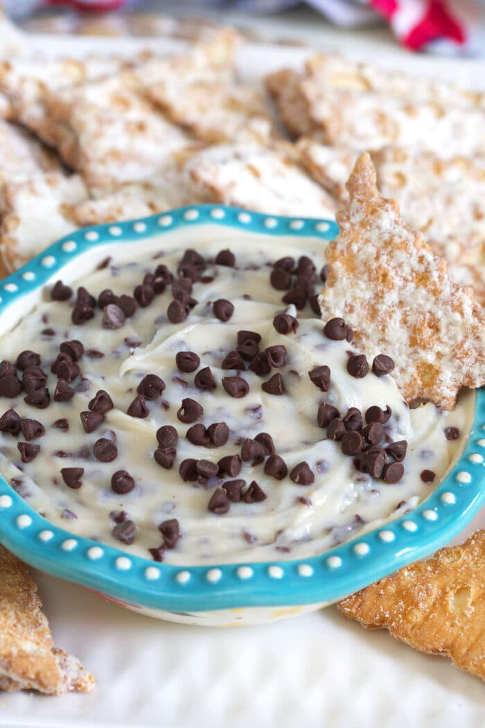 A small blue and white bowl is filled with sweet cannoli dip.