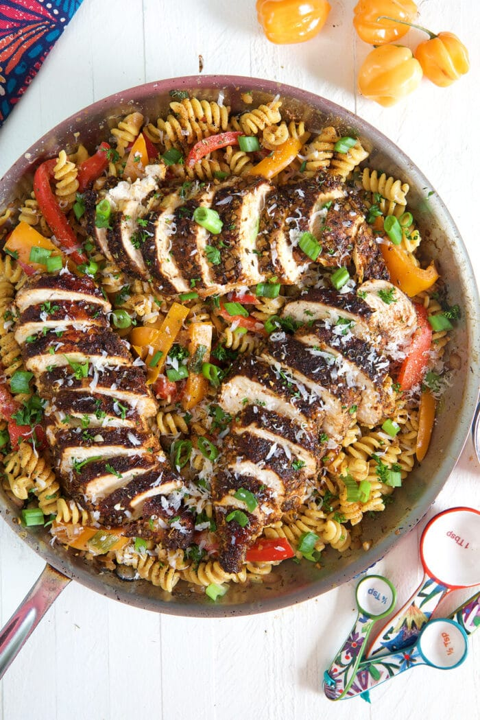 A pot is filled with cooked pasta and chicken.