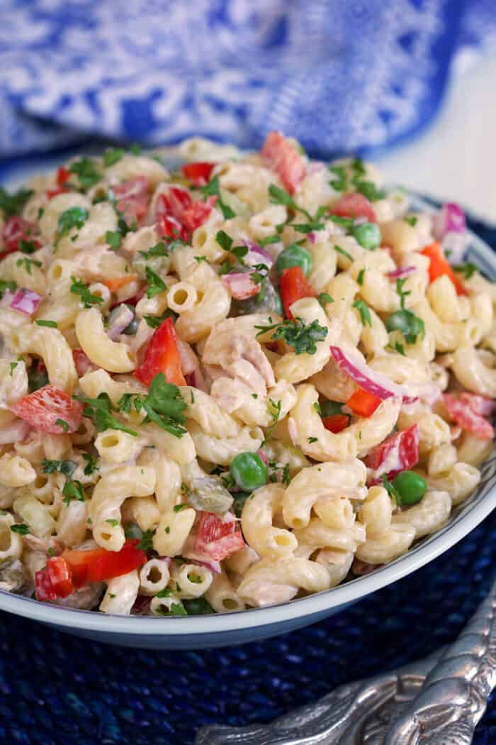 A macaroni salad is garnished with parsley.