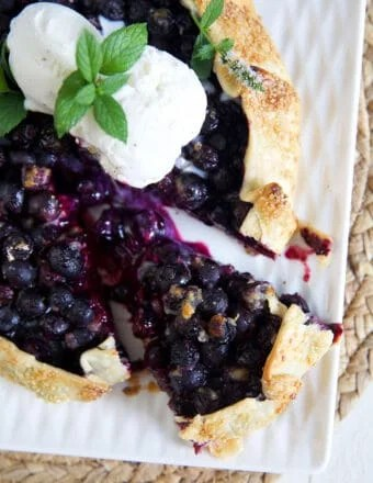 Blueberry Galette with a slice cut out of it.