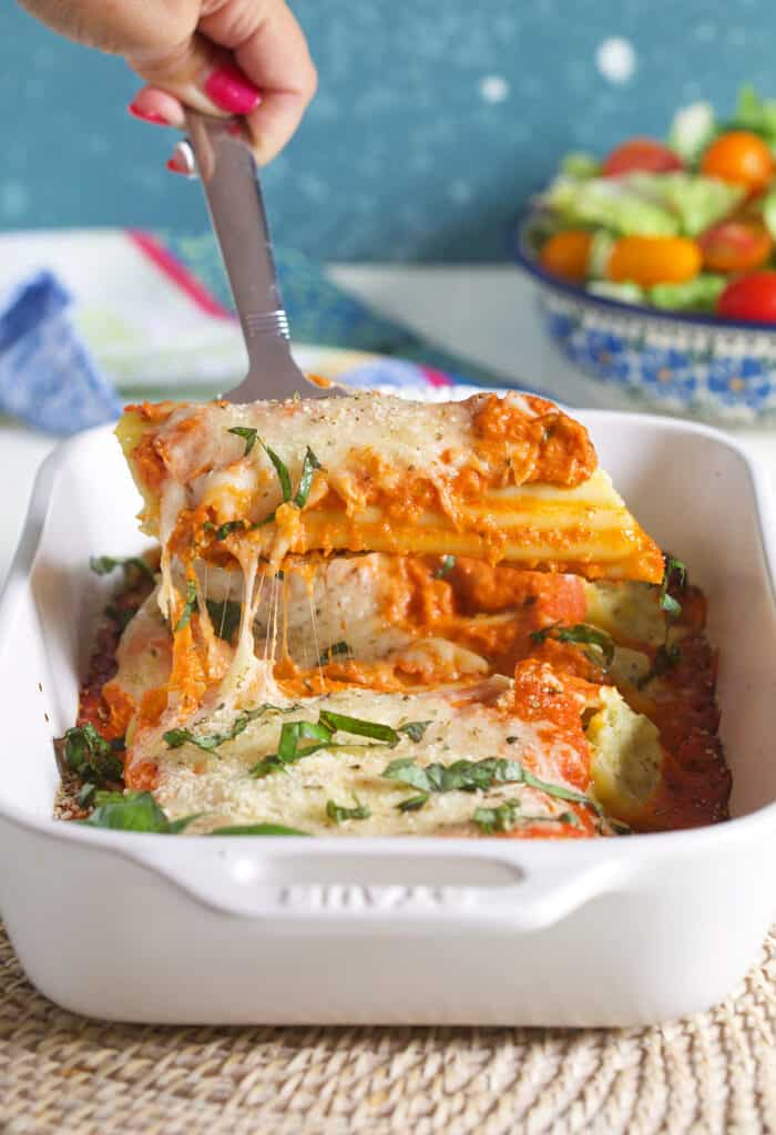Manicotti being served with a spatula