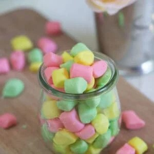 Colorful butter mints are in a small glass.