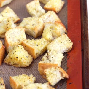 Croutons are baked on a siplat baking sheet.