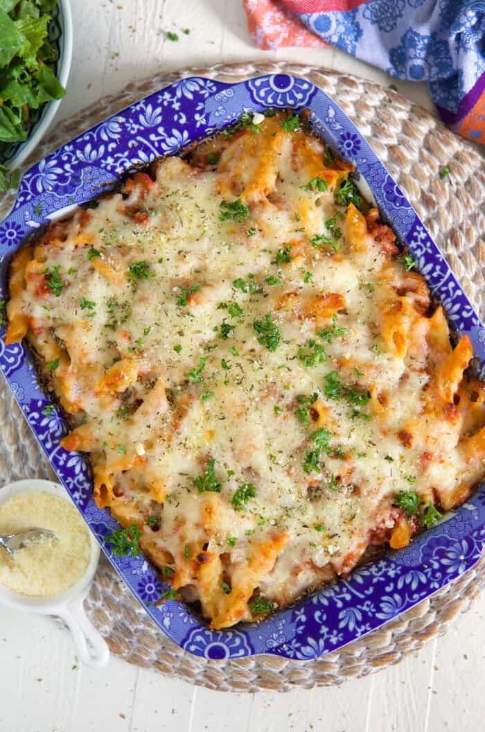 Mostaccioli is baked to perfection and garnished with a sprinkle of fresh parsley.