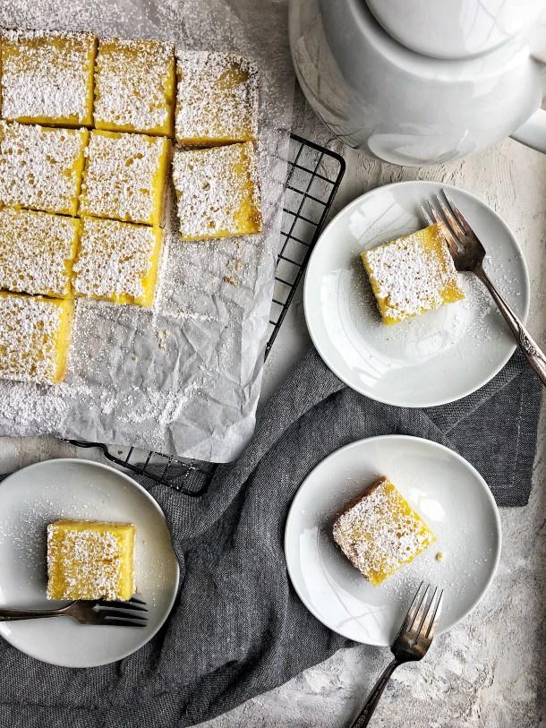 lemons bars on plates with forks