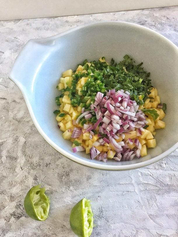 pineapple salsa ingredients in bowl