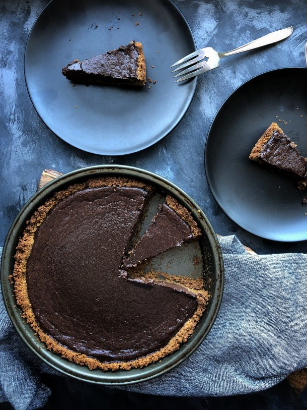 A bittersweet chocolate filling spiced with cinnamon, ground ginger, cayenne, and vanilla. A crumbly, messy graham cracker crust that tastes like home. If you like spicy food, you will love this pie!