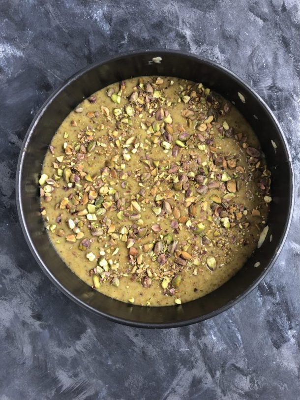 A simple, modern cake that's mixed in one bowl. Not too sweet. A dense yet tender crumb. Fragrant cardamom to up the sophistication factor. And a generous studding of pistachios on top.