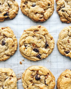 chocolate chip and toffee cookies on parchment paper