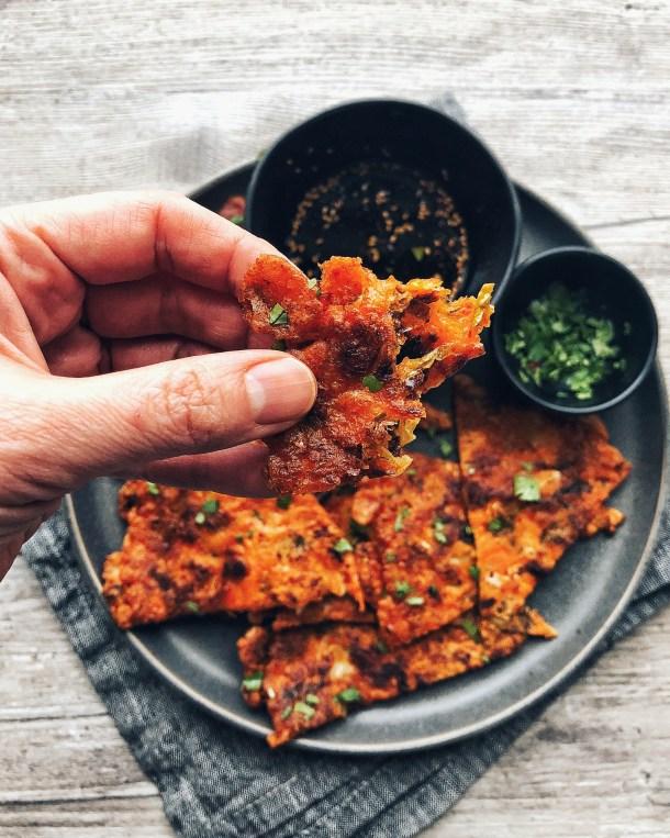 kimchi pancake, held by hand