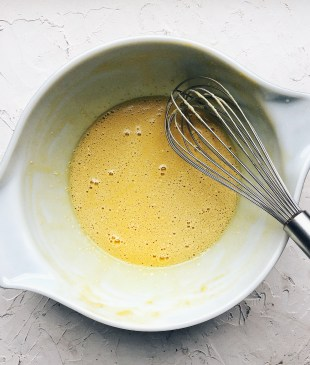 dutch pancake batter in bowl with whisk
