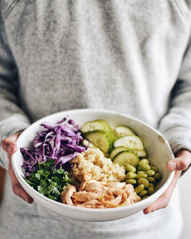 Asian Rice bowl held by person with two hands