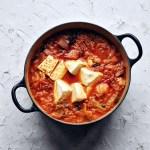 big pot of kimchi stew (kimchi jjigae) with ladle