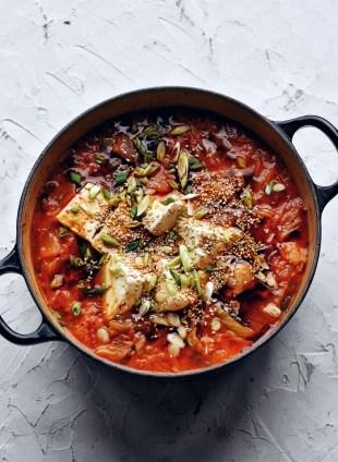 black pot of kimchi stew (kimchi jjigae)