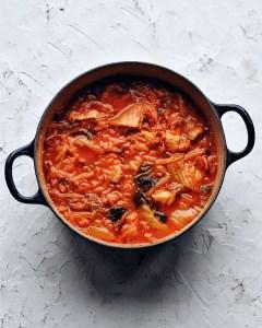 big pot of braised kimchi stew (kimchi jjigae) with pork belly