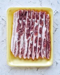 fresh pork belly in styrafoam tray