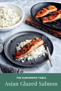 Asian Glazed Salmon with rice on dinner plate with more rice and salmon in the background