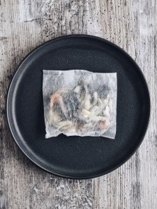 dashi packet on grey plate