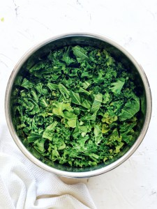 instant pot filled with kale