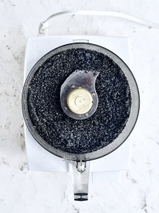 food processor filled with black sesame seed powder