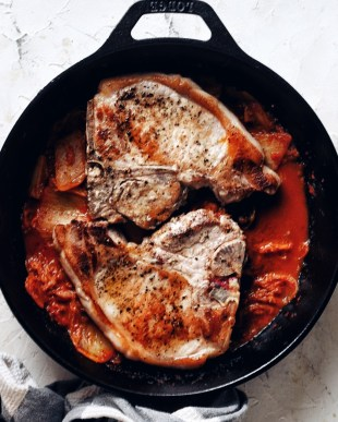 korean pork chops in cast iron pan with kimchi pan sauce