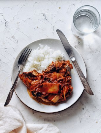 korean pork chops with kimchi pan sauce on plate, served with rice