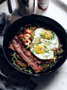skillet filled with breakfast food items