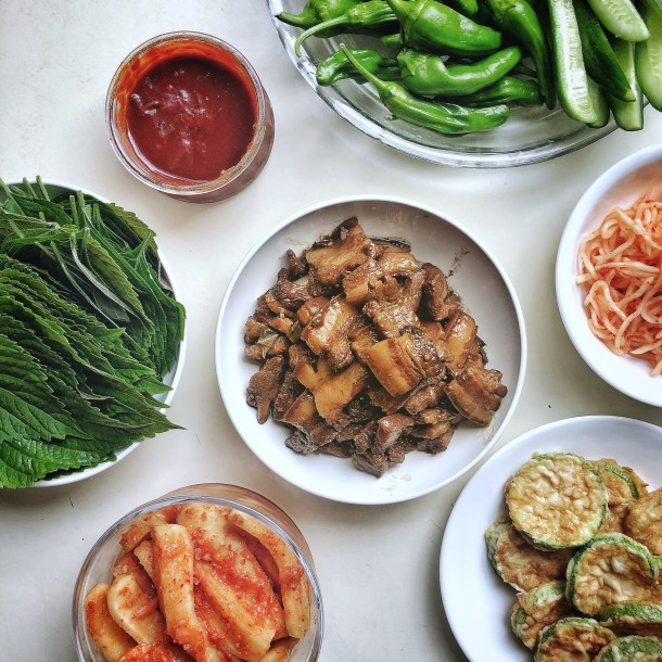 several banchan on a white surface