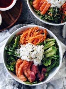 a bowl of Hwe Dup Bap (korean sushi bowl) on a napkin