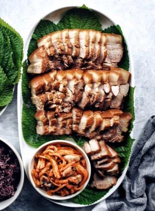 oval platter of Korean Bo ssam with radish kimchi