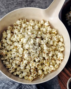 white bowl of parmesan popcorn with black pepper
