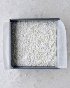 raw batter for coconut mochi cake in square pan