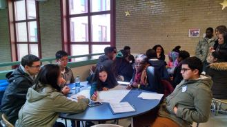 Scholars divided into small groups based on their areas of interest and brainstormed possible career paths based on those interests. For example, those who gravitate toward data-driven tasks might pursue careers in engineering, while someone who loves people might work in marketing or as a therapist.