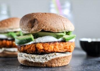 smoky sweet potato burgers with roasted garlic cream and avocado via how sweet eats