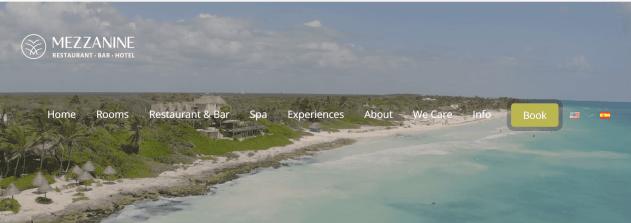 Logo of Mezzanine hotel showing webpage menu overtop an island view