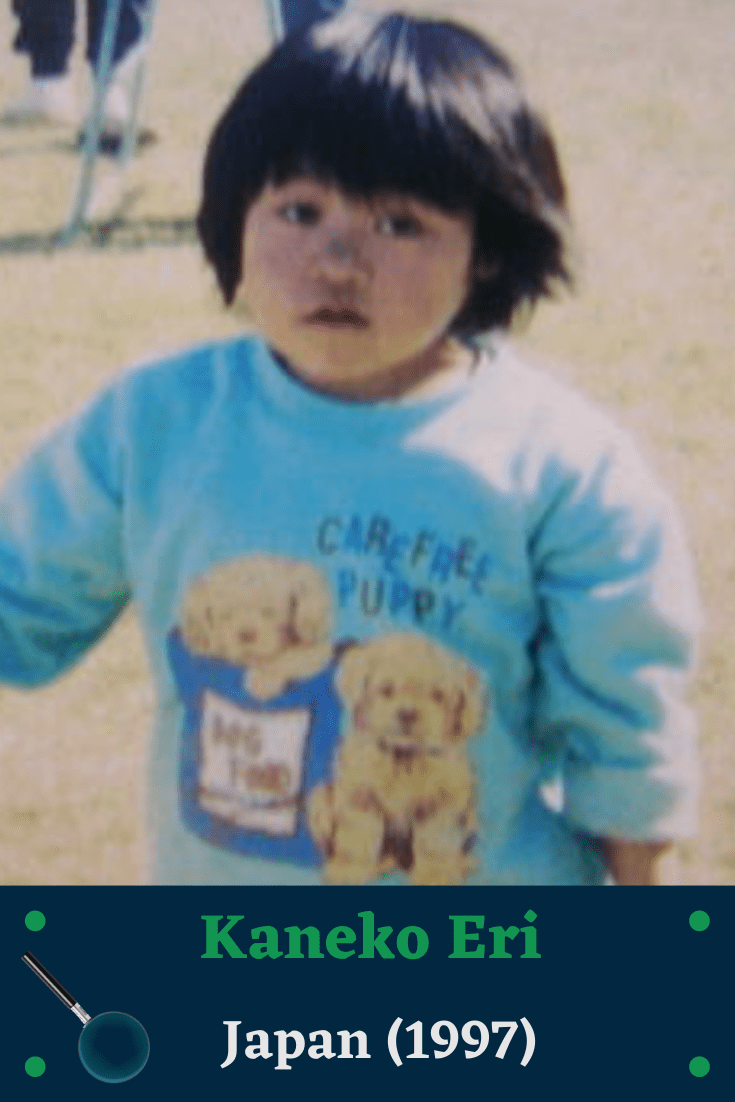 Eri Kaneko wearing the long sleeved blue shirt, two puppies on the chest with the words 'carefree puppy'. One puppy is in a dark blue bag that says 'dog food'