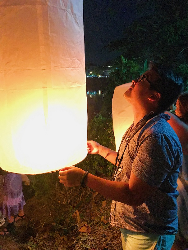 Lighting up a lantern Overnight bus How to Spend $40 Per Day in Thailand