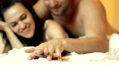 stock-footage-young-lovers-in-the-bed-focus-on-their-hands