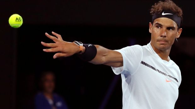 Nadal rolls over Raonic to reach semi-finals