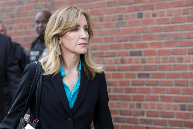 Felicity Huffman and 12 parents plead guilty to college fraud